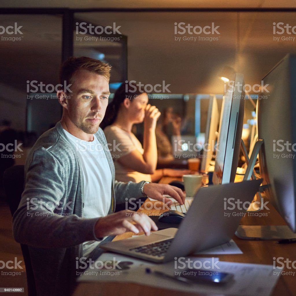 The night owls in networking mode stock photo