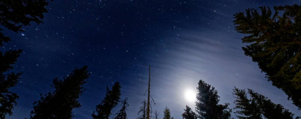 The Night Sky at the John Muir Lodge with clouds crossing the moon stock photo