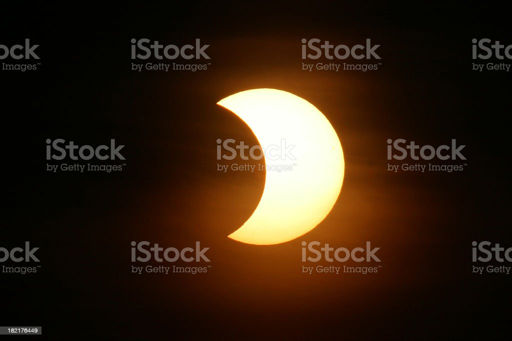 The nights sky with a partial solar eclipse stock photo