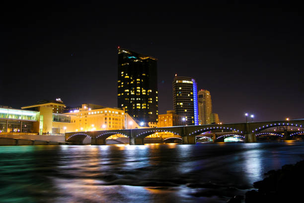The nighttime skyline of the city of Grand Rapids Michigan cityscape stock photo