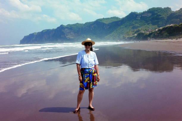 The nineties. At the Beach of Parangtritis. Yogyakarta, Indonesia. stock photo