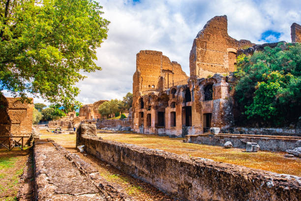 The Ninfeo stadium ruins in Villa Adriana of Hadrians Villa archaeological site of UNESCO in Tivoli - Lazio - Italy The Ninfeo stadium ruins in Villa Adriana of Hadrians Villa archaeological site of UNESCO in Tivoli - Lazio - Italy . fossilized pitch stock pictures, royalty-free photos & images