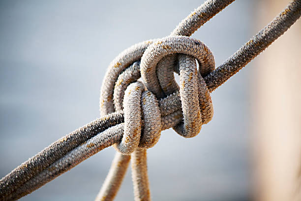 the noose noose in a quay harbour - close up view with sea background sailor stock pictures, royalty-free photos & images
