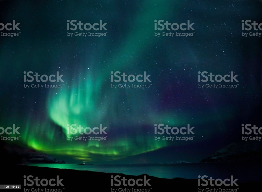 The northern lights aurora borealis in blue and green stock photo