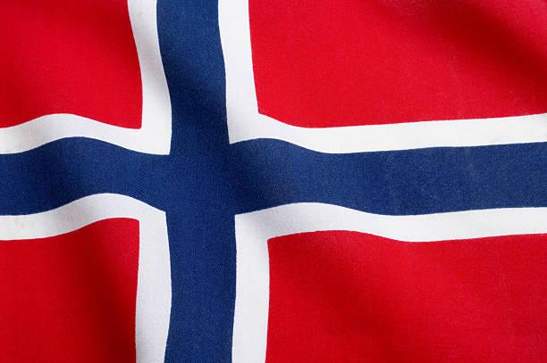 the norwegian flag waving in the wind - noorse vlag stockfoto's en -beelden