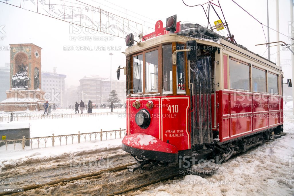 The nostalgic tram in Taksim Square on a snowy winter day stock photo
