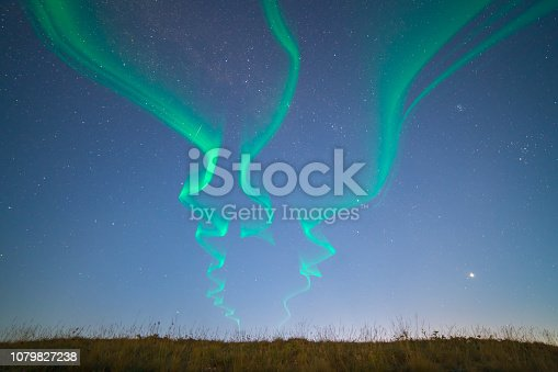 The nothern light on the background of the starry sky. evening night time