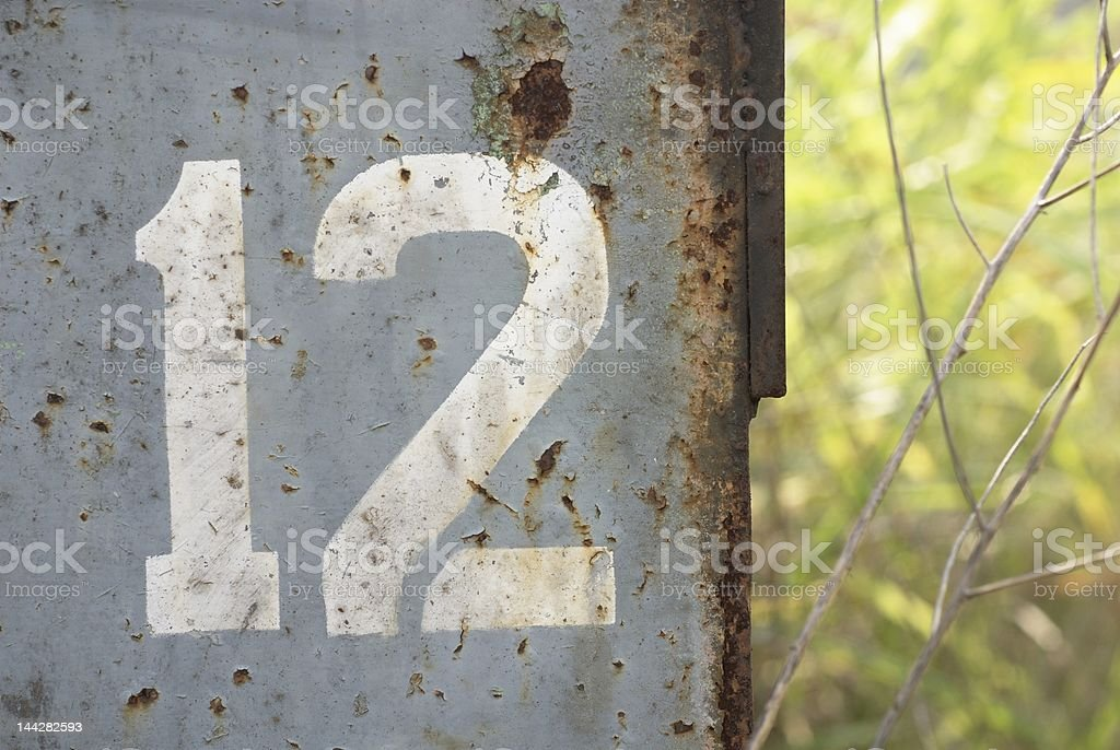 the number 12 stenciled on rusted metal royalty-free stock photo