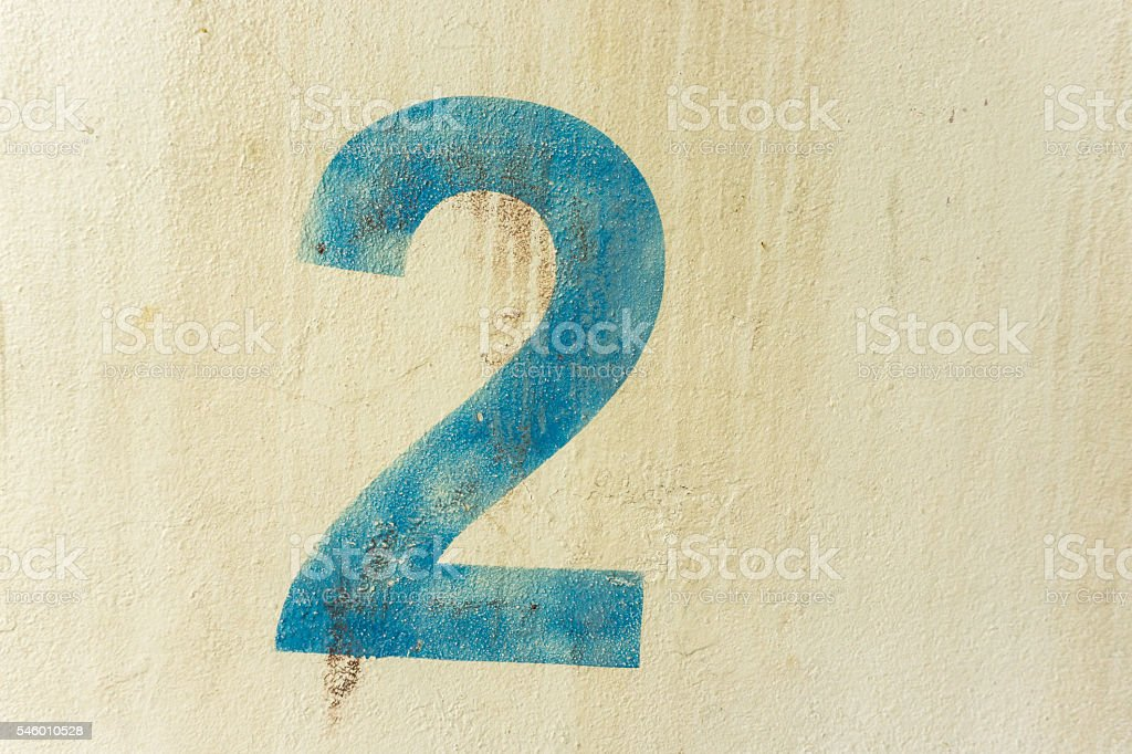 the number 2 on the dirty  wall stock photo