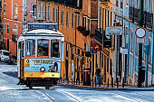 Lisbon, Portugal - August 03, 2018: The number 28 Lisbon tram, considered one of the main attractions of the city, passes through the popular tourist districts of Graca, Alfama, Baixa and Estrela.