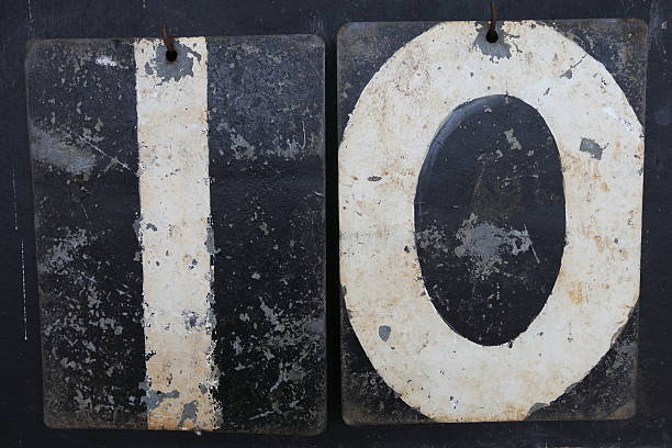 The number ten on an old cricket scoreboard stock photo