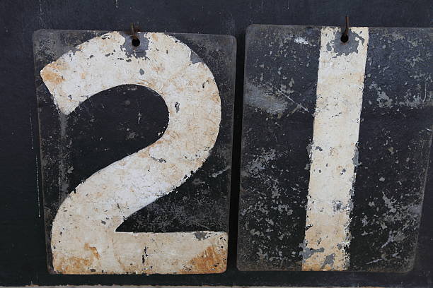 the number twenty-one on an old scoreboard - number 21 stock photos and pictures