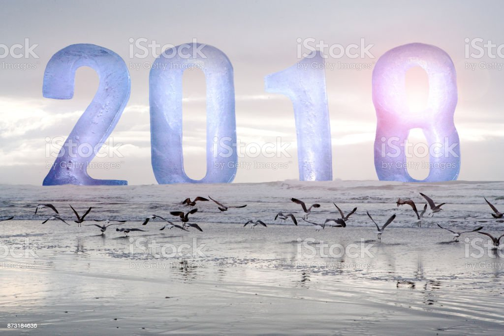 the numbers 2018 above the ocean stock photo