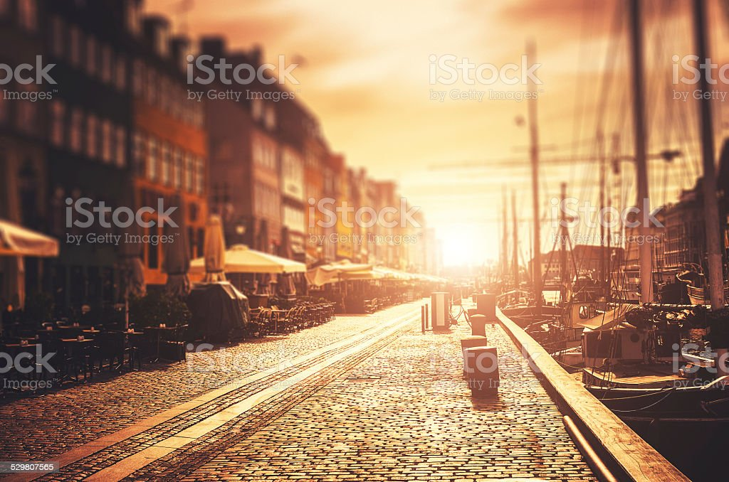 The Nyhavn harbour at sunrise in Copenhagen stock photo