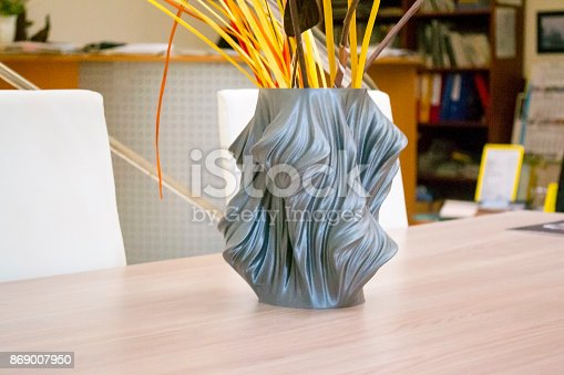 istock The object printed on the 3d printer stands on the table 869007950