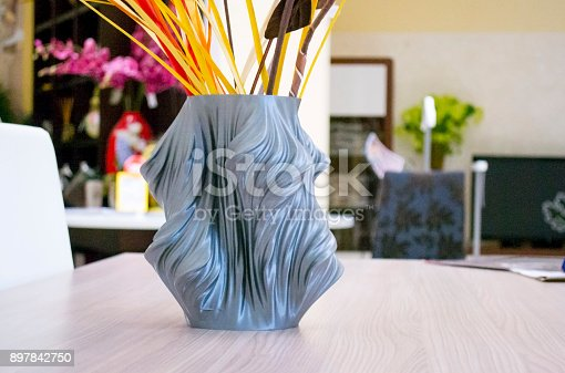 istock The object vase printed on the 3d printer stands on the table 897842750
