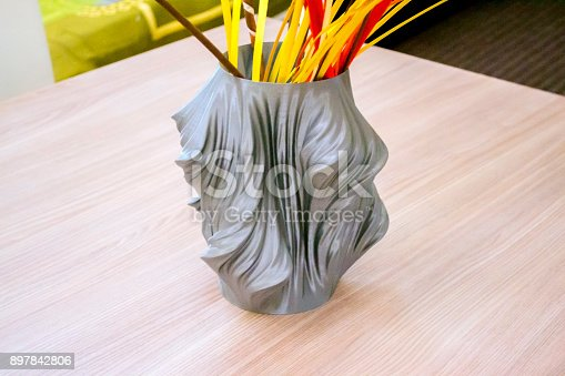 istock The object vase printed on the 3d printer stands on the table 897842806