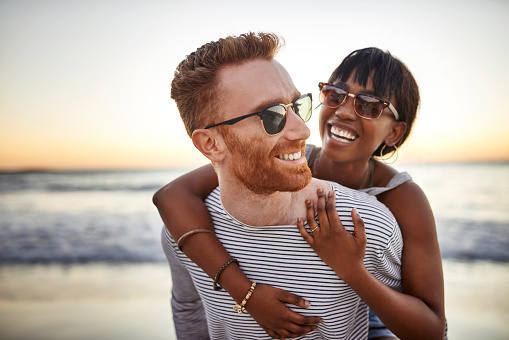 Shot of a happy young couple spending the day at the beach