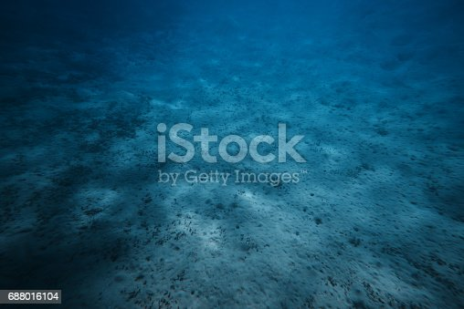 horizontal shot of the sand on the ocean floor. no people.