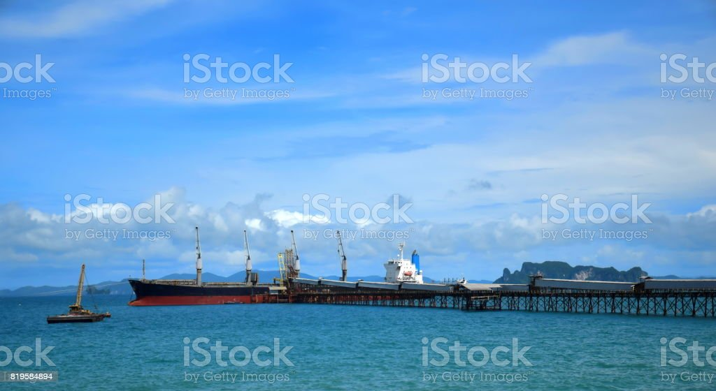 The Ocean liner ship is discharging cargo at the port. stock photo