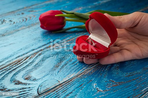 istock The offer to get married. A gift for St. Valentine's Day. Marriage proposal. 910829652