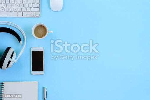 The office blue desk and equipment for working with coffee in top view and flat ray concept.