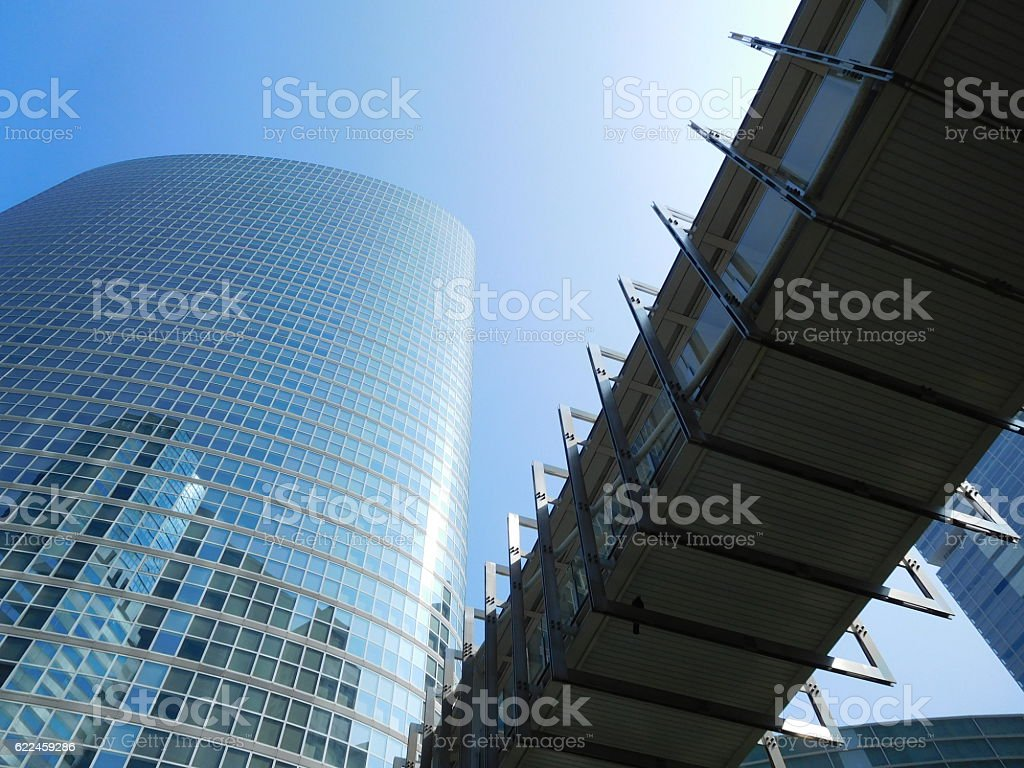 The office buildings and the footbridge under the blue sky stock photo
