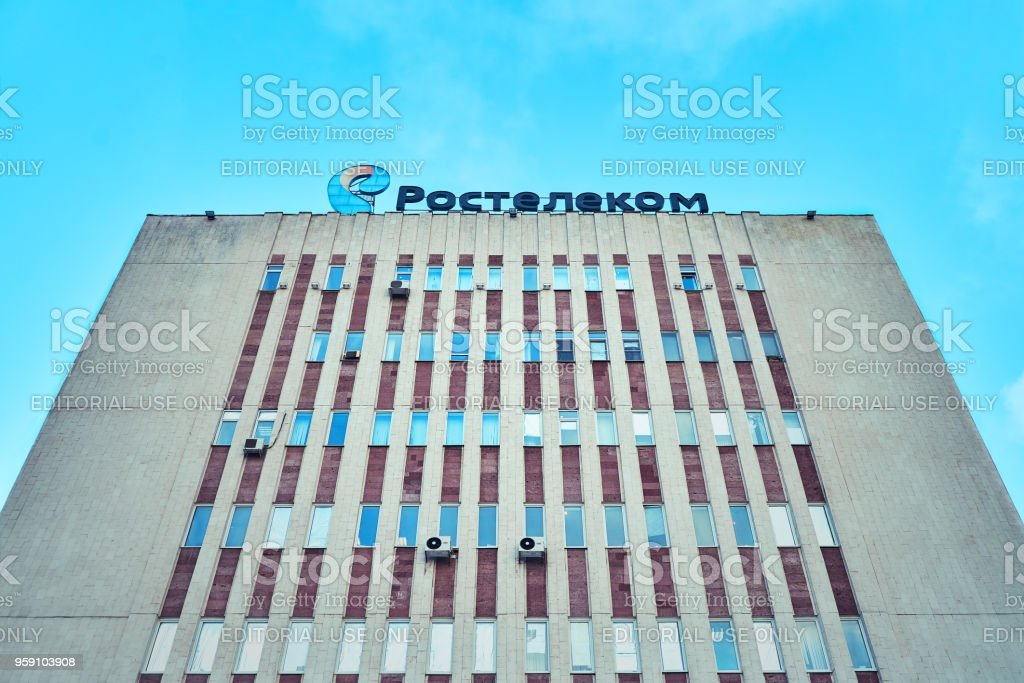 The office of a large telephone company and the Internet provider Rostelecom inscription on the roof of a tall house