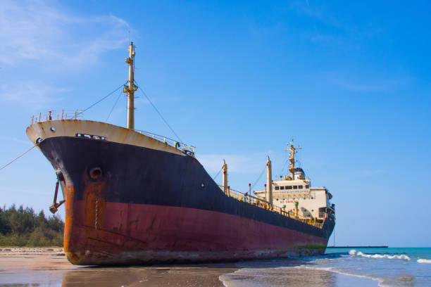 the oil tanker hit by waves crashing ashore - stranded stock pictures, royalty-free photos & images