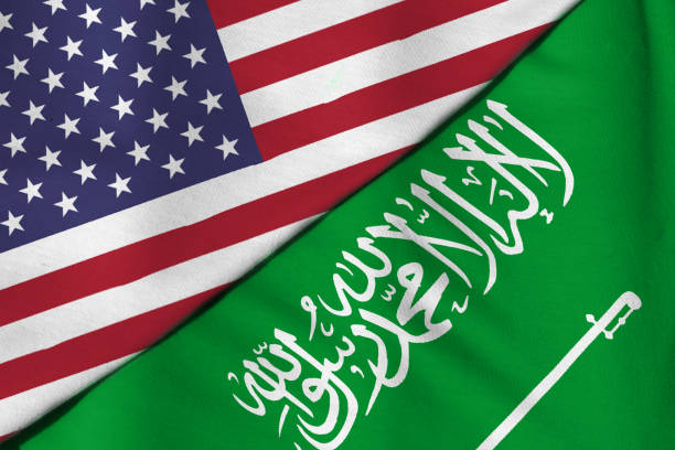 The Oil wars. Flag of Saudi Arabia. Flag of the United States. The Oil wars. Flag of Saudi Arabia. Flag of the United States. saudi arabia stock pictures, royalty-free photos & images