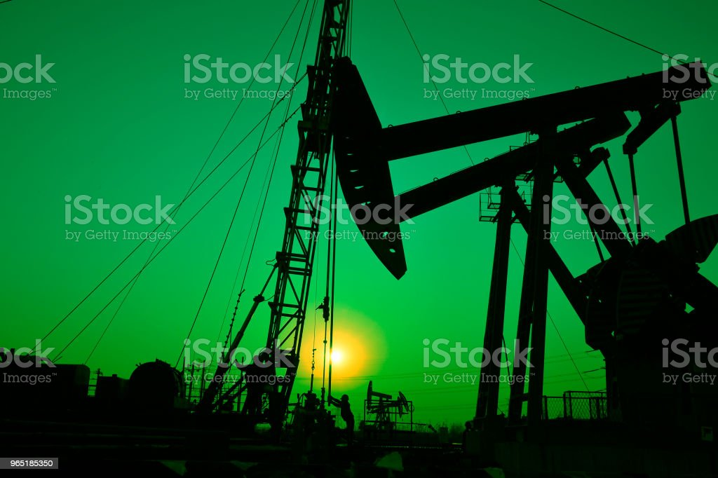 The oil workers in the job royalty-free stock photo