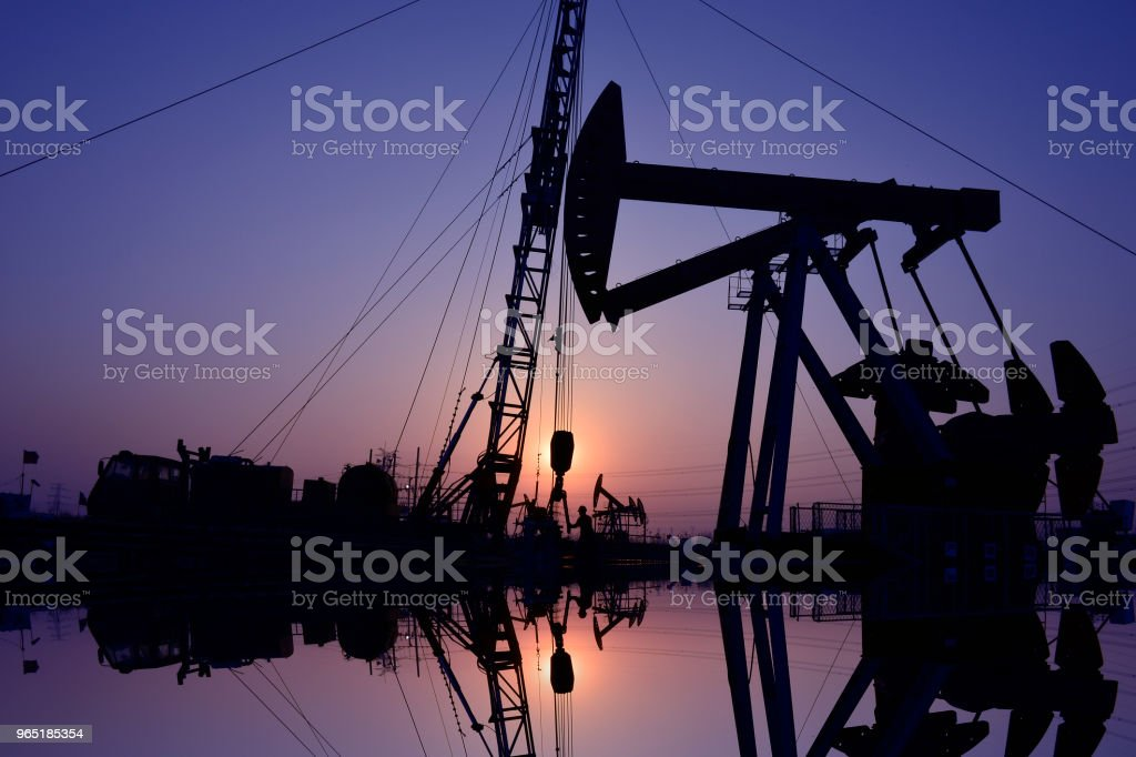The oil workers in the job zbiór zdjęć royalty-free