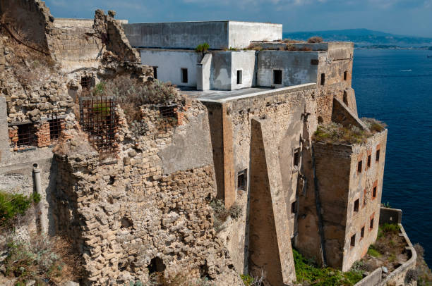 The old abandoned prison in the historic Palazzo d'Avalos on the Terra Murata cliffs, Procida Island, Italy stock photo