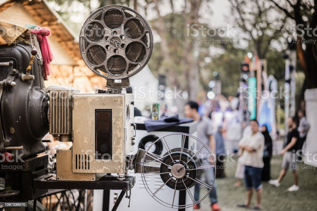 The old analog rotary film movie projector at outdoor cinema movies...