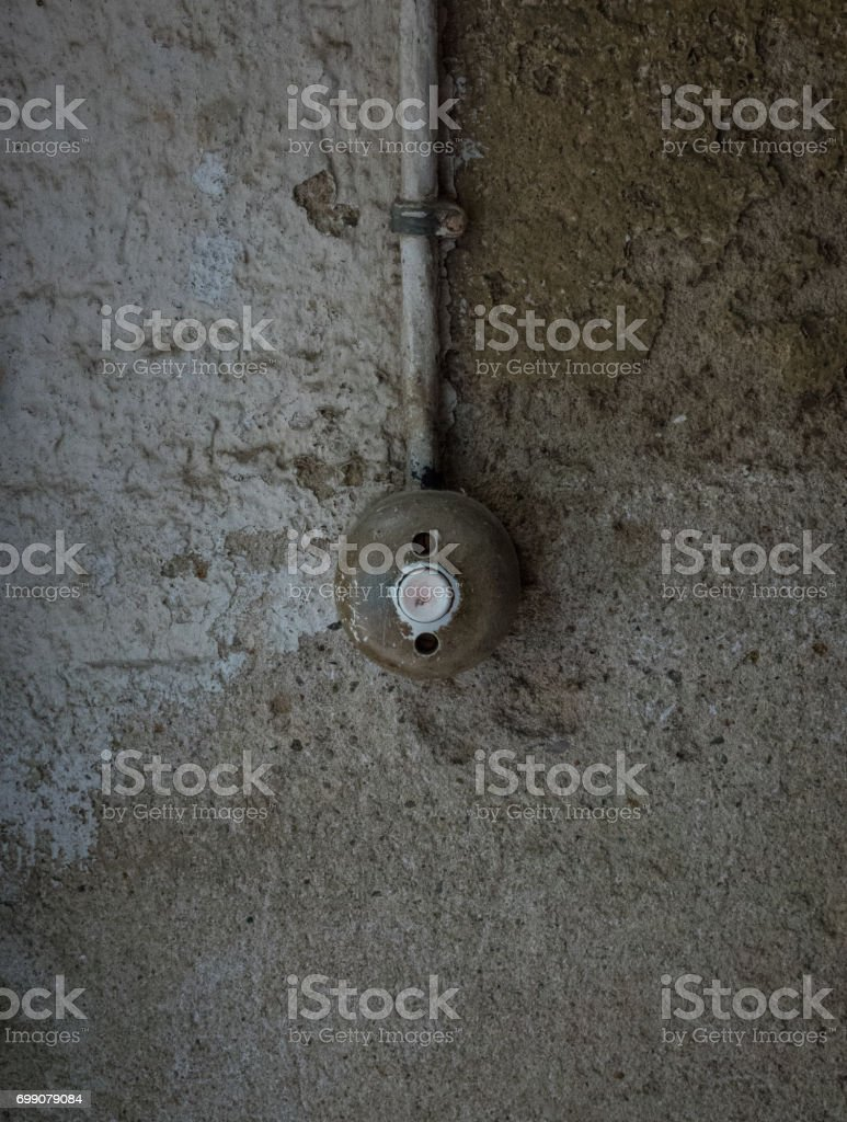 The old and ancient bell on a wall stock photo