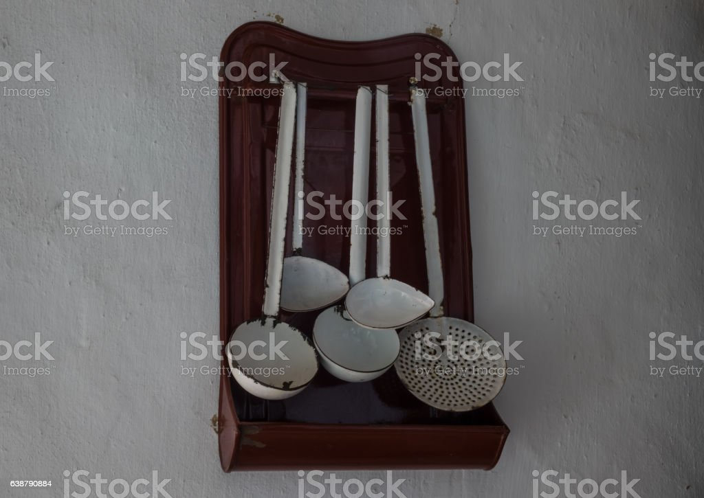 The old and ancient utensils on a wall stock photo