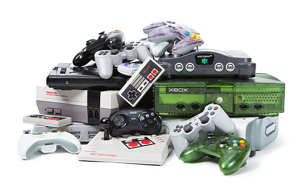 The Old and New of Console Gaming Taipei, Taiwan - November 13, 2012: This is a studio shot of various game systems and controllers isolated on a white background. nintendo stock pictures, royalty-free photos & images