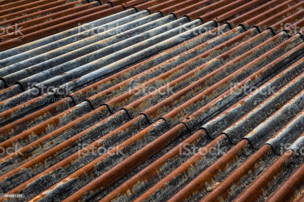 The old and rusty iron roof of a building stock photo