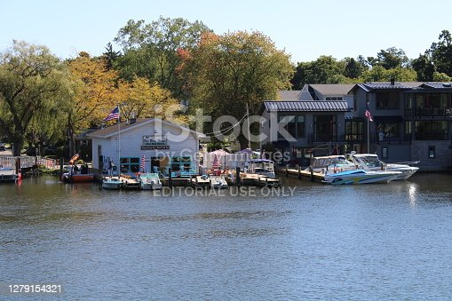 An adorable little retro boat rental shop and restaurant/bar in the beautiful little town of Saugatuck in Michigan, USA. Also, an apartment and small boat dock next door.