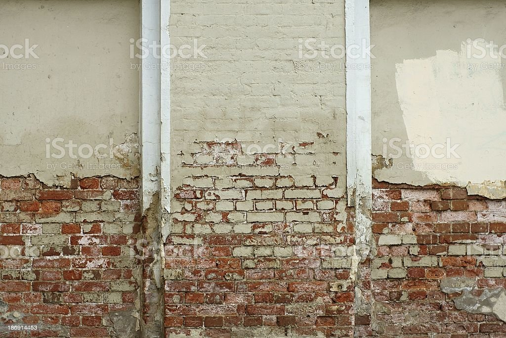 The old brick wall collapses royalty-free stock photo