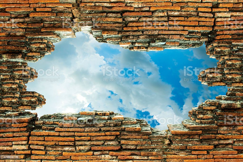 The old brick walls are broken and see the sky stock photo