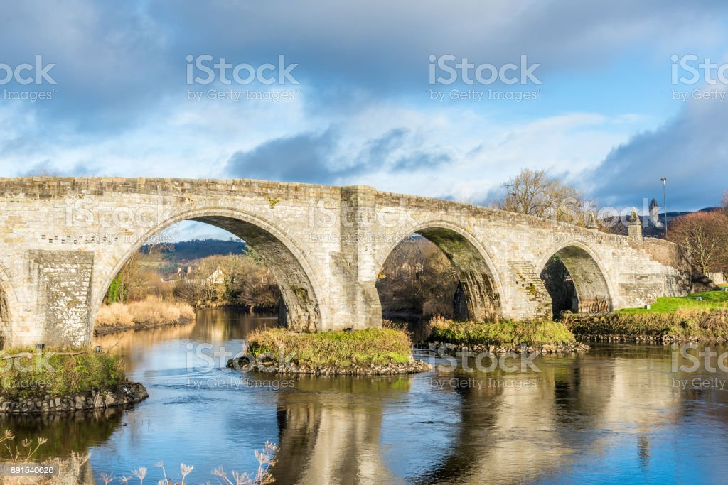 The Old Bridge in Stirling with the Wallace Monument in the Distance stock photo