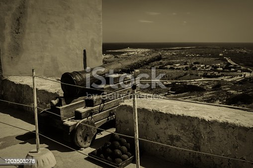 An Old Cannon with cannon balls in the Red Tower in Malta.