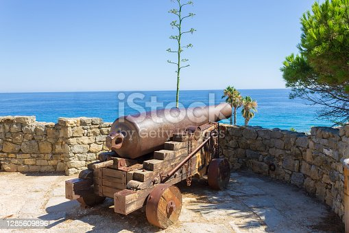 The old cannon named Marabutto against the sea in Bordighera, Italy