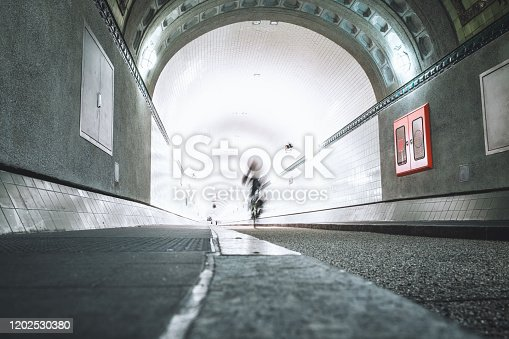 view into the illuminated old Elbtunnel in Hamburg