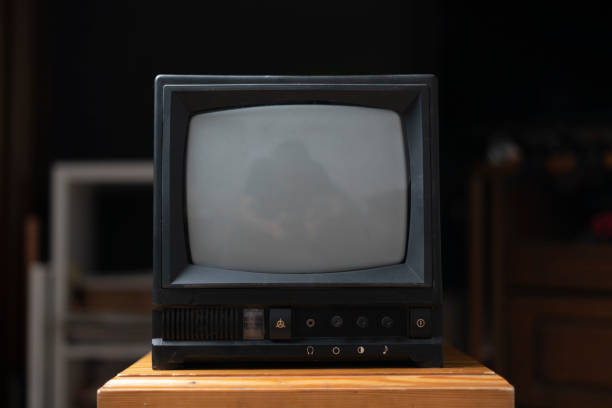 the old fashioned vintage tv television on the shelf at home stock photo