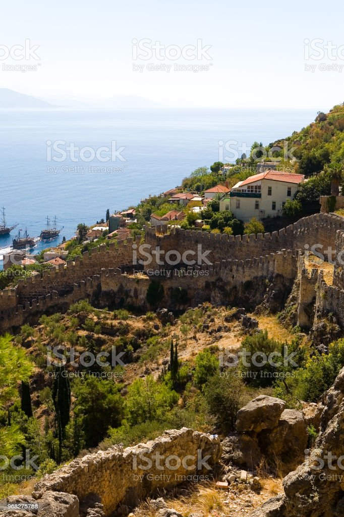 The old fortress wall of Alanya against the background of the sea....