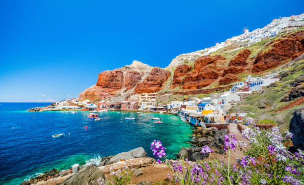 The old harbor of Ammoudi under the famous village of Ia at Santorini, Greece. stock photo