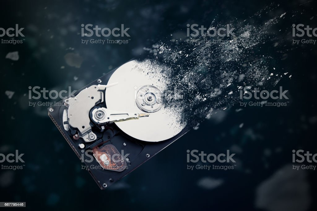 The old hard disk drive is disintegrating in space. stock photo
