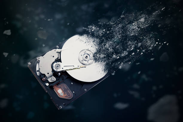 the old hard disk drive is disintegrating in space. - destruição imagens e fotografias de stock